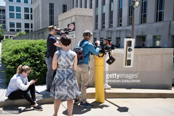 Press watch a court entrance after the bail of former Trump campaign chairman Paul Manafort was revoked during a hearing at federal court June 15...