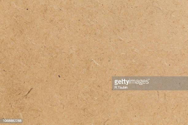 pressed beige chipboard texture. wooden background - grainy stock pictures, royalty-free photos & images