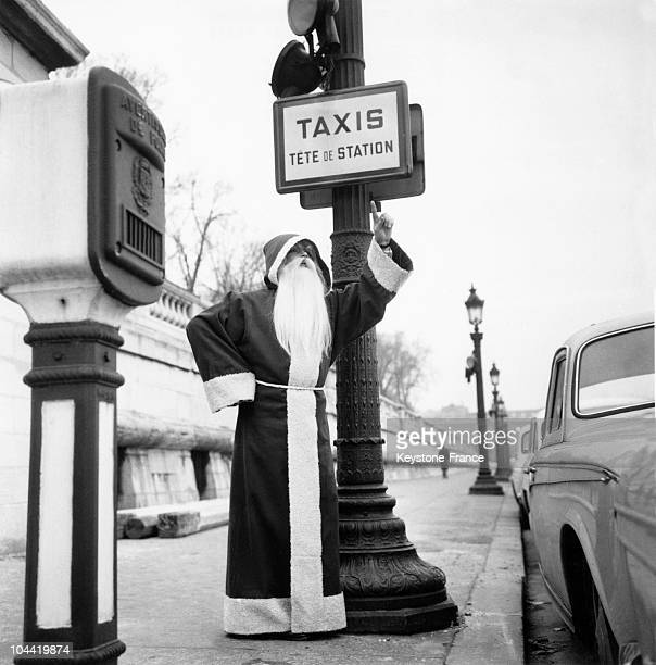 Pressed For Time On The Eve Of His Busiest Night Of The Year Santa Claus Was Seen Hailing A Taxi In Paris On December 23 1960