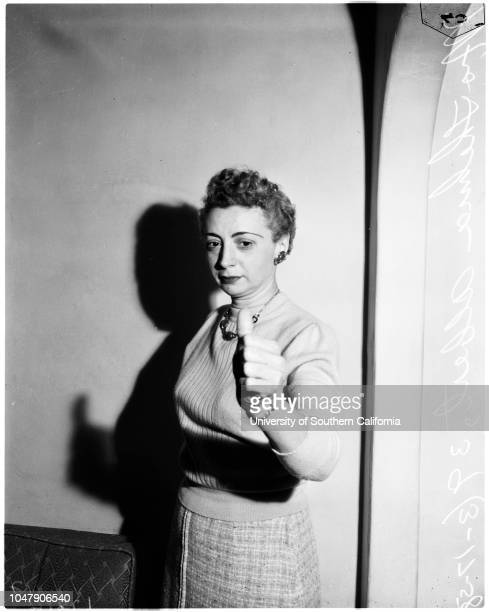 Pressed thumb against muzzle of bandit's gun and screamed, 17 March 1958. Mrs Thelma Albert -- 39 years .;Caption slip reads: 'Photographer: Swaim....