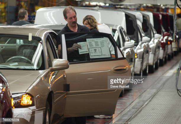 GM PRESSER03/02/05Grant Alexander places the price sticker on a car's window on the last stop on the line assembling GM Monte Carlo's and Impalas...
