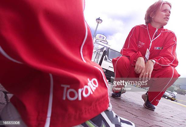 CANADA112th IOC SESSIONOlympic diver Anne Montminy sits waiting for a team shuttle to leave on Thursday after the candidate city press conference at...