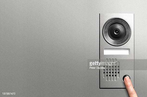 pressing video door entry system with copy space - intercom stock pictures, royalty-free photos & images