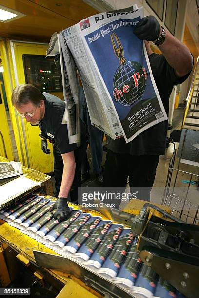 Pressman James Herron examines copies of the last ever print edition of the Seattle PostIntelligencer as it rolls off the presses on March 16 2009 in...