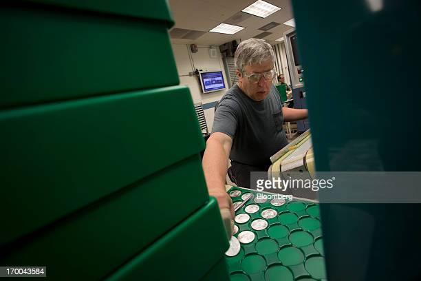 Pressman Larry Norton inspects a oneounce silver bullion coin at the United States Mint at West Point in West Point New York US on Wednesday June 5...