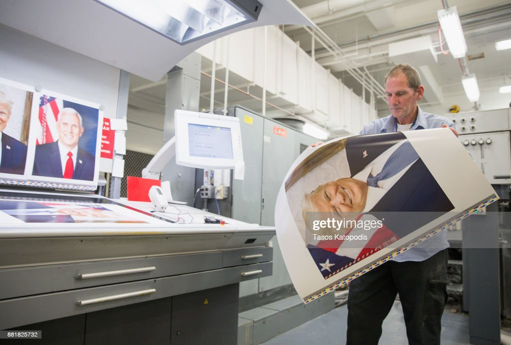 Pressman Mike Stone takes samples from the printing press to check the color on the official photograph of President Donald J. Trump at the Government Publishing Office on November 29, 2017 in Washington, DC.