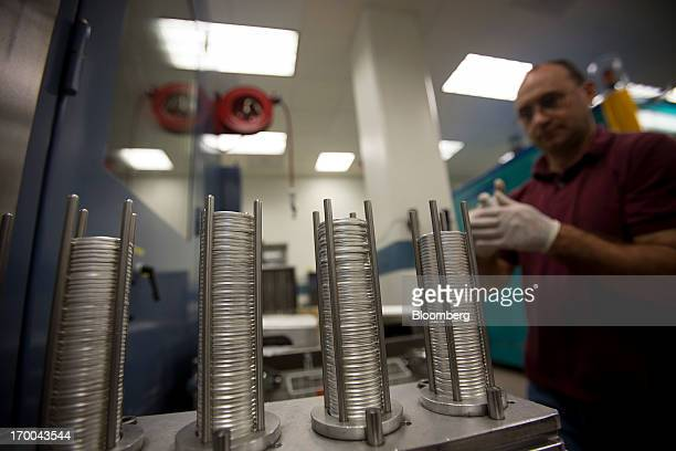 Pressman Sam Guerra works with oneounce silver bullion coin blanks at the United States Mint at West Point in West Point New York US on Wednesday...