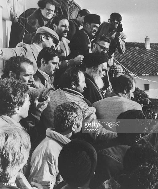 Pressmen surround Iranian political and religious leader Ayatollah Khomeini after the announcement that the Shah has left Iran. The Ayatollah plans...