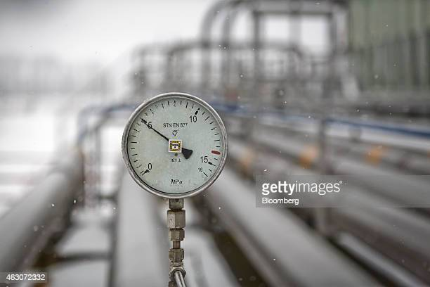A pressure gauge sits on outdoor pipework at the underground gas storage facility operated by RWE AG in Dolni Dunajovice Czech Republic on Monday Feb...