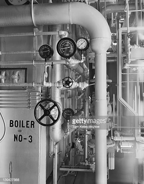 pressure gauges on pipes in factory - pressure gauge stock photos and pictures