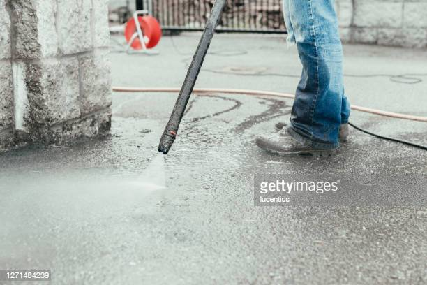 pressure washer used to clean driveway - tarmac stock pictures, royalty-free photos & images