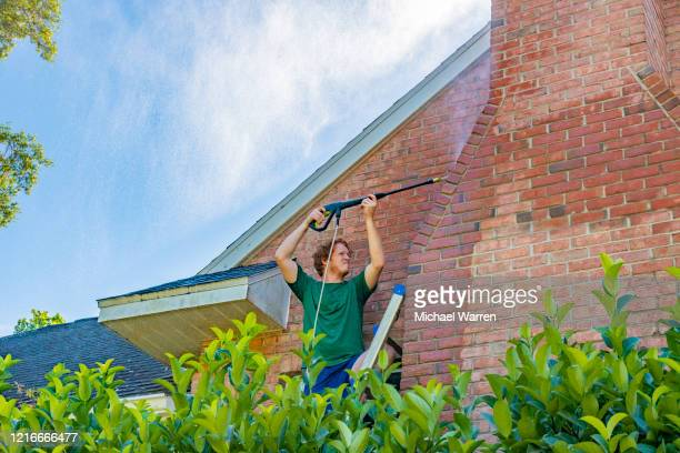 pressure washing a brick house - high pressure cleaning stock pictures, royalty-free photos & images