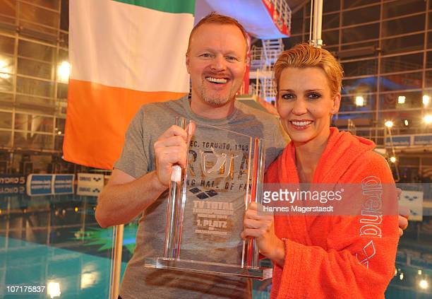 Prestenter Stefan Raab and actress Alexandra Rietz, winner of the competition, pose during the TV Total Turmspringen - TV Show at the Munich...