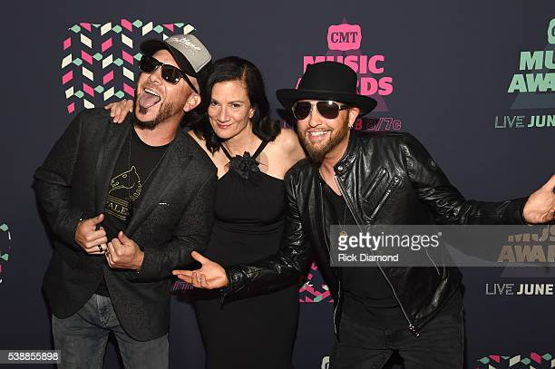 Preston Brust and Chris Lucas from musical duo LoCash and Senior Vice President of Music Strategy for CMT Leslie Fram attend the 2016 CMT Music...