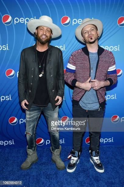 Preston Brust and Chris Lucas of LOCASH attend Planet Pepsi PreSuper Bowl LIII party featuring Travis Scott on February 1 2019 in Atlanta Georgia