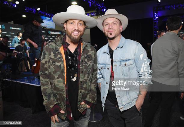 Preston Brust and Chris Lucas of LOCASH attend SiriusXM at Super Bowl LIII Radio Row at Georgia World Congress Center on February 1 2019 in Atlanta...
