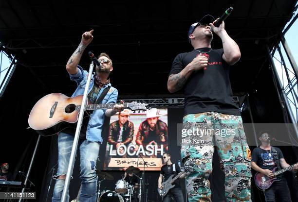 Preston Brust and Chris Lucas of LOCASH perform live during the Daytime Village at the 2019 iHeartCountry Festival Presented by Capital One at the...