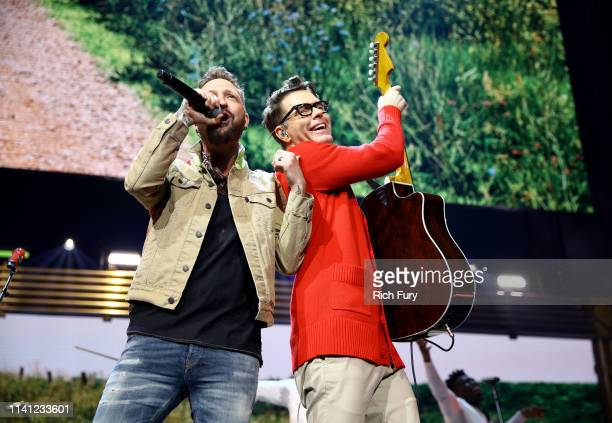 Preston Brust of LOCASH and Bobby Bones of Bobby Bones and the Raging Idiots perform onstage during the 2019 iHeartCountry Festival Presented by...