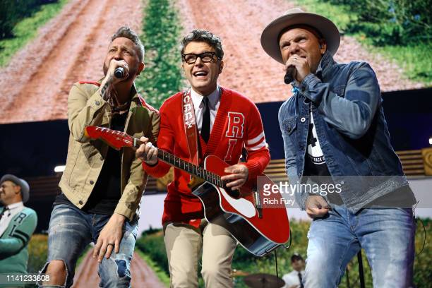 Preston Brust of LOCASH Bobby Bones of Bobby Bones and the Raging Idiots and Chris Lucas of LOCASH perform onstage during the 2019 iHeartCountry...