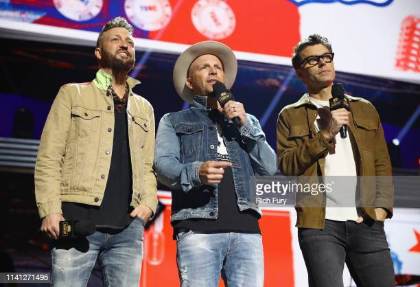 Preston Brust of LOCASH Chris Lucas of LOCASH and host Bobby Bones speak onstage during the 2019 iHeartCountry Festival Presented by Capital One at...