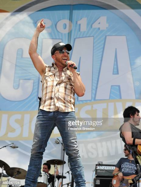 Preston Brust of the LoCash Cowboys performs on the Chevy Riverfront Stage at the 2014 CMA Festival on June 7 2014 in Nashville Tennessee