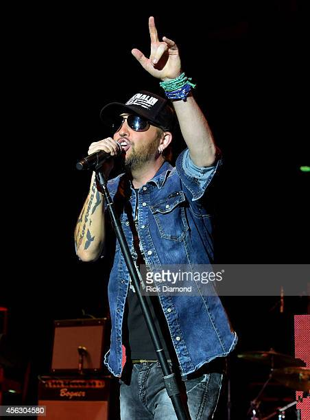 Preston Brust of the LoCash Cowboys performs onstage at the Paradigm Agency at the Paradigm Party during Day 2 of the IEBA 2014 Conference on...