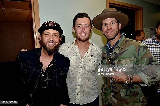Preston Brust Scotty McCreery and Drake White attend the 7th Annual 'Darius And Friends' Concert at Wildhorse Saloon on June 6 2016 in Nashville...