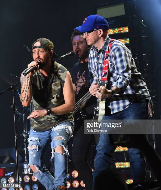 Preston Burst and Chris Lucas of LoCash joined onstage by Tim Richards PD KMLE Country Radio 1079FM perform during Day 1 Country Thunder Music...