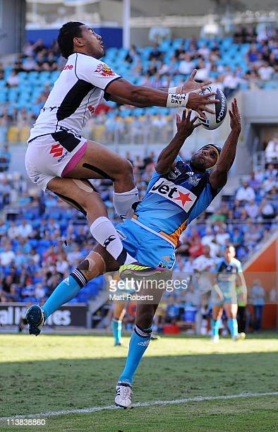 Preston Campbell of the Titans contests for the high ball with Krisnan Inu of the Warriors during the round nine NRL match between the Gold Coast...