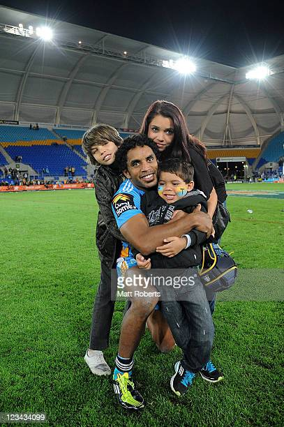 Preston Campbell of the Titans poses for a photo with his family after the round 26 NRL match between the Gold Coast Titans and the Parramatta Eels...