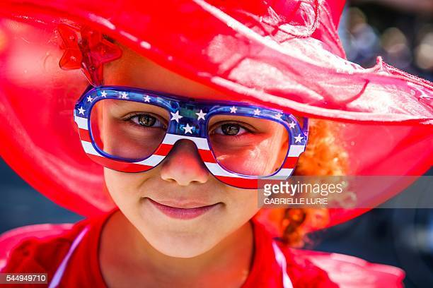 Preston Chilcott posed for a portrait as she walks through the 4th of July Parade in Alameda California on Monday July 4 2016 / AFP / GABRIELLE LURIE
