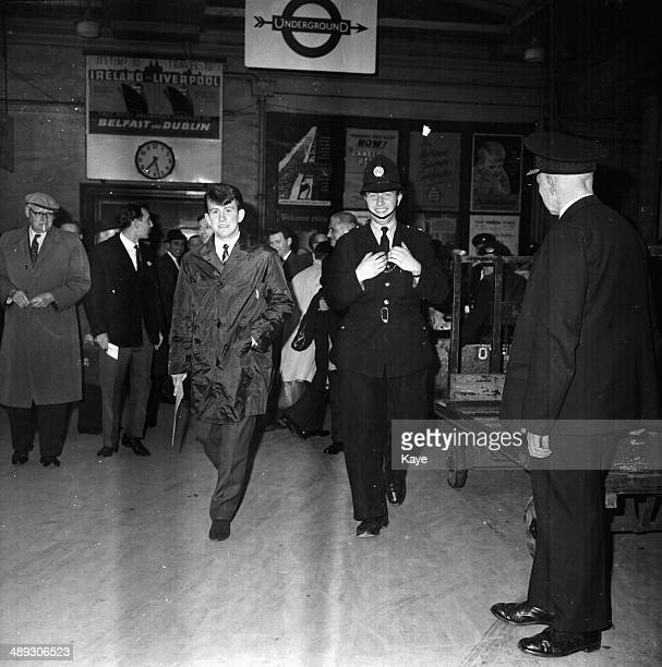 Preston Football Club's Howard Kendall, being escorted through a train station, in the city for his teams match at Wembley Stadium, London, April...