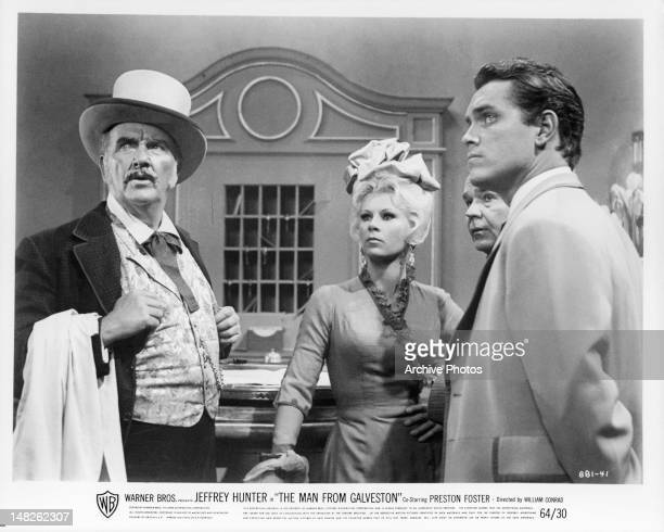 Preston Foster Grace Lee Whitney and Richard Carlson all looking up in a scene from the film 'The Man From Down Under' 1943