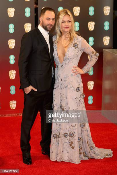 Preston JCook and Julia Stiles attend the 70th EE British Academy Film Awards at Royal Albert Hall on February 12 2017 in London England