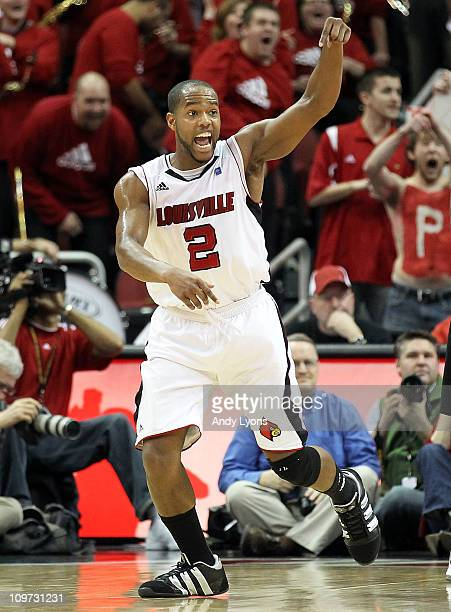 Preston Knowles of the Louisville Cardinals celebrates making a basket to end the first half during the Big East Conference game against the...