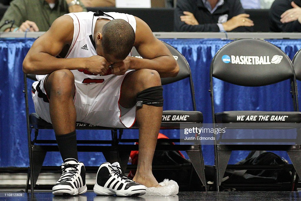 Preston Knowles #2 of the Louisville Cardinals reacts after coming out of the game because of an injury while playing against the Morehead State Eagles during the second round of the 2011 NCAA men's basketball tournament at Pepsi Center on March 17, 2011 in Denver, Colorado.