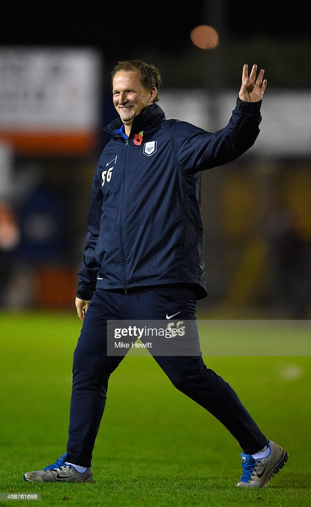 Preston manager Simon Grayson salutes the travelling fands at the end of the FA Cup First Round match between Havant & Waterlooville FC and Preston North End on November 10, 2014 in Havant, England.