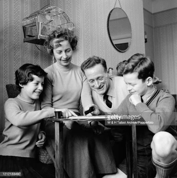 Preston North End and England footballer Tom Finney enjoys a board game at home with his wife Elsie and two children Barbara and Brian in Preston,...