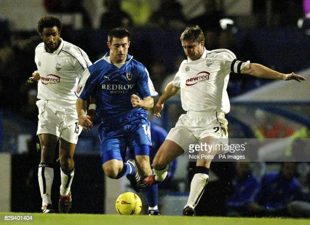 Preston North End defender Chris Lucketti and Youl Mawene clears the ball away from Cardiff City striker Alan Lee during the CocaCola League one...