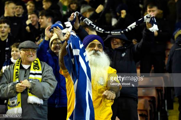 Preston North End fan celebrates during the Sky Bet Championship match between Barnsley and Preston North End at Oakwell Stadium on January 21 2020...