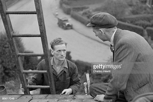 Preston North End footballer Tom Finney at work high up on a ladder 2nd November 1946 Picture Post 4243 Finney The Footballer Who Stops The Game pub...