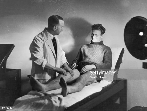 Preston North End footballer Tom Finney receiving treatment from the club physio, 2nd November 1946. Original Publication - Picture Post - 4243 -...