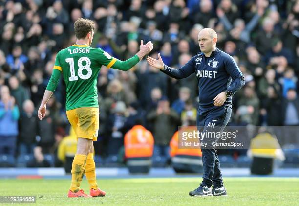 Preston North End manager Alex Neil greets Ryan Ledson as they celebrate at the final whistle during the Sky Bet Championship match between Blackburn...