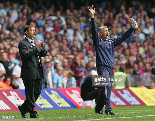 Preston North End manager Billy Davies and West Ham manager Alan Pardew shout instructions during the CocaCola Championship PlayOff Final between...