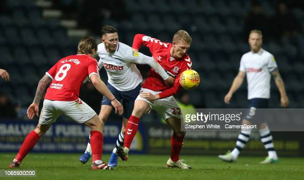 Preston North End's Alan Browne battles with Middlesbrough's Adam Clayton and George Saville during the Sky Bet Championship match between Preston...