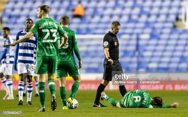 Preston North End's Alan Browne lies injured during the Sky Bet Championship match between Reading and Preston North End at Madejski Stadium on...