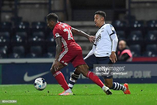 Preston North End's Alex JohnBaptiste battles with Cardiff City's Kadeem Harris during the Sky Bet Championship match between Preston North End and...
