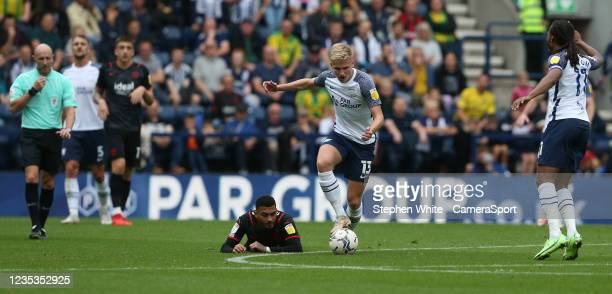 Preston North End's Ali McCann avoids the challenge from West Bromwich Albion's Karlan Grant during the Sky Bet Championship match between Preston...