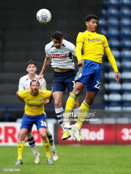 Preston North End's Andrew Hughes battles with Birmingham City's Jude Bellingham during the Sky Bet Championship match between Preston North End and...