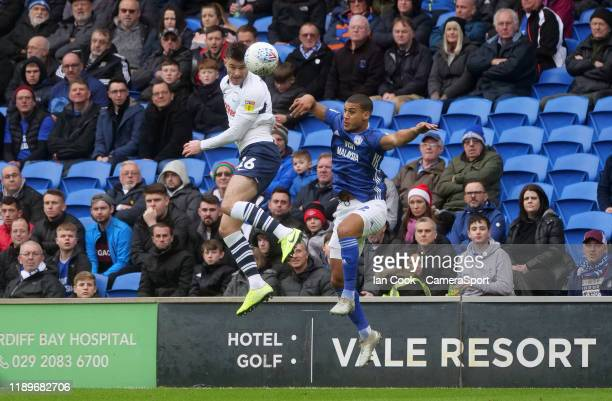 Preston North End's Andrew Hughes beats Cardiff City's Lee Peltier to the header during the Sky Bet Championship match between Cardiff City and...